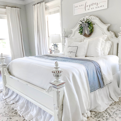 Stearns & Foster Lux Estate mattress in a white and blue styled bedroom by Heatherlane.